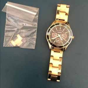 Gold and black fossil watch